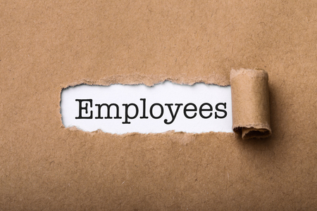 Paper tear with the word Employees.