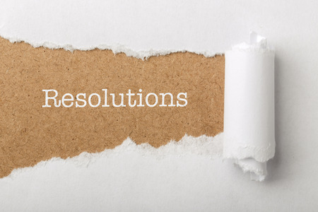 Paper tear with the word Resolutions.