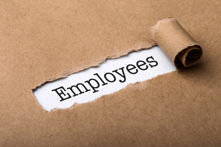Paper tear with the word Employees. Imagens