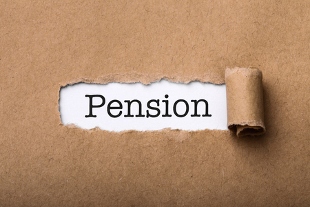 Paper tear with the word Pension.