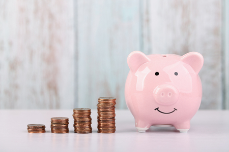 Piggy bank with growth coins which means growth business success concept.