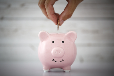 Save money concept with blank white copy space background.