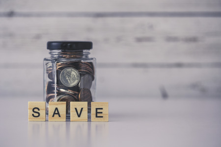 Save money concept with blank white copy space background. Stock Photo