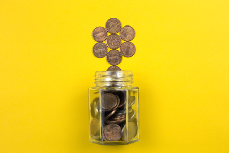 Money growing and saving concept. Business financial growth with yellow background. Stockfoto