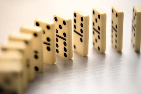Domino effect shot on white background.