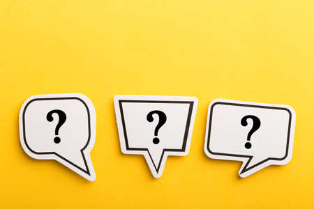 Question mark speech bubble isolated on yellow background.