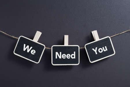 We Need You concept small blackboard hanging on line. Stockfoto
