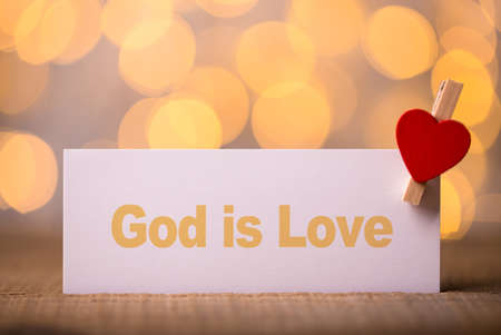 God is Love concept signboard with beautiful background.