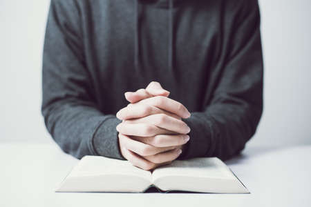 Man is praying on the white table.