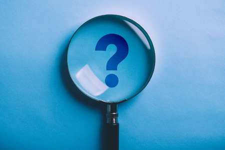 Magnifying With Question Mark is isolated on the blue background.