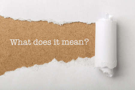 What Does It Mean Concept word written under torn paper.