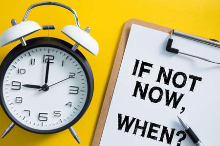 If Not Now When concept with clock aside. Archivio Fotografico