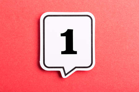 Number One Speech Bubble isolated on red background. Banco de Imagens