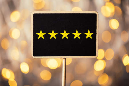 Five yellow stars concept black sign billboard isolated. Stock Photo