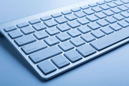 Closeup shot of keyboard with blue color.