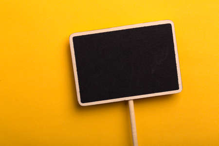 Blank Blackboard Sign Board Isolated on colored background.