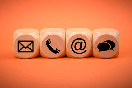Contact Methods. Close-up of a phone, email, chat and post icons wooden block. 스톡 콘텐츠
