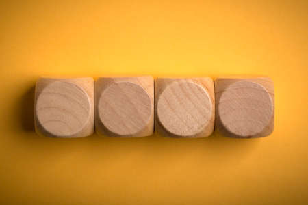 Four blank wooden blocks isolated on color background. 스톡 콘텐츠