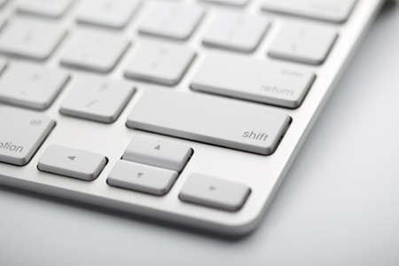 Closeup shot of white keyboard on white background. 스톡 콘텐츠