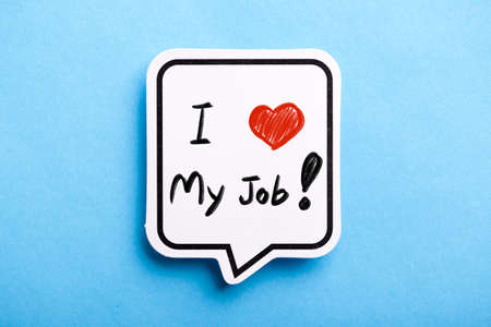 I Love My Job concept speech bubble isolated on blue background. 스톡 콘텐츠