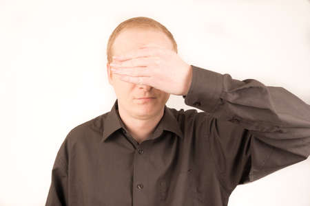 covering: man covering eyes with hand