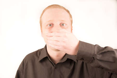 covering: man covering mouth with hand