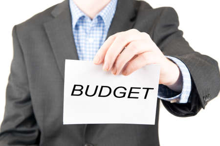 business sign: business man with sign budget Stock Photo