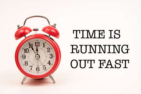 quota: alarm clock with time is running out fast almost text