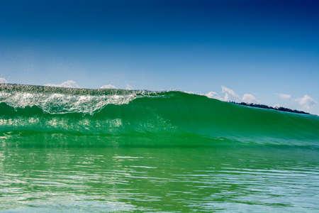 Wave break in crystal clear waters at Campeche beach in Florian?polis Brazil