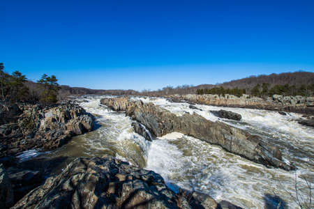 rushing white water in great falls park, virginia side in winter