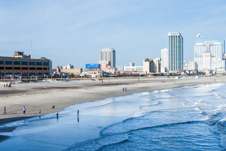 Beach in Atlantic City, New Jersey with boardwalk in background