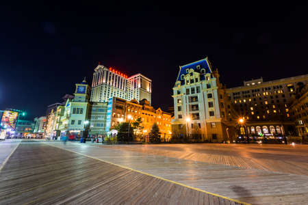 Skyline of Atlantic City, New Jersey at night at the boardwalk Editorial