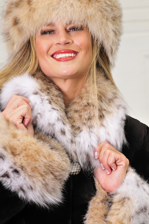 chearful: Attractive Russian woman wearing a fashionable fur coat and fur hat