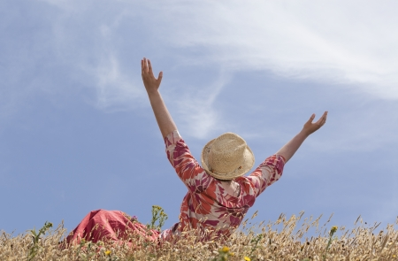 Woman with hands raised toward heaven photo
