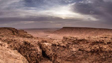 Rocky mountains beneath stormy sunset in Moroccan part of Sahara desert 版權商用圖片