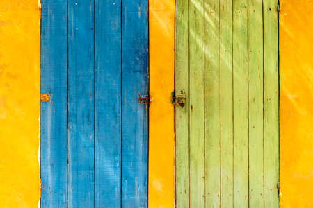 Blue and green door yellow wall multi colors vibrant africa