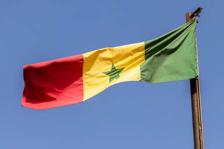 Wooden Pole Senegal National Colors Flag Red Yellow Green Star Standard-Bild - 139602411