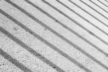 Background design pattern: Striped shodows on a sidewalk black and white 写真素材