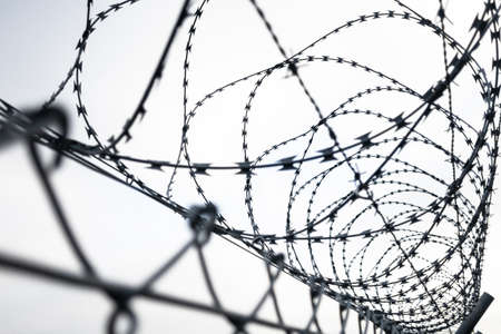 Barbed wire fence prison security