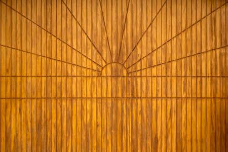 Background design pattern: Closed garage door wooden paneling