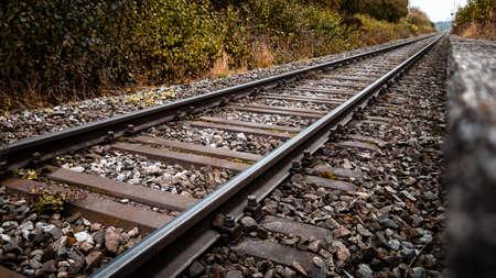 Railroad tracks in autumn diminishing perspective Archivio Fotografico