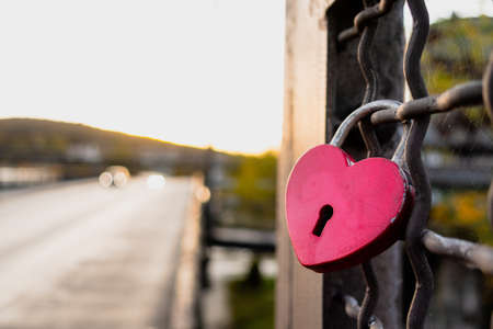 Red Love Padlock on a Wire Fence Fidelity Promise