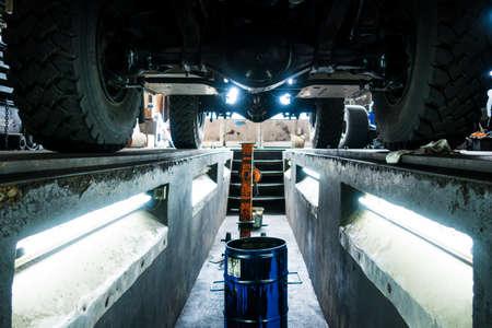 Off-road Truck in a Garage Workshop from below