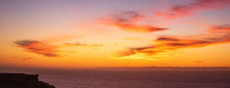 Sunset over a high cliff Atlantic ocean Morocco Archivio Fotografico