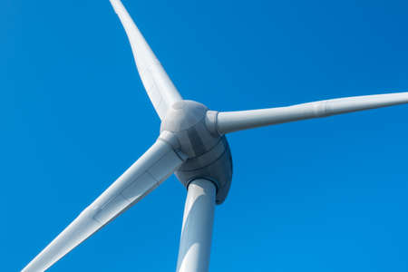 Wind turbine propeller close-up with blue cloudless sky