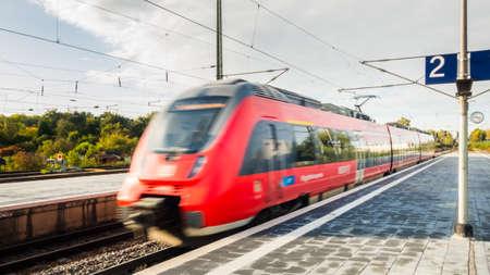 Deutsche Bahn train departing from or arriving at railway station platform