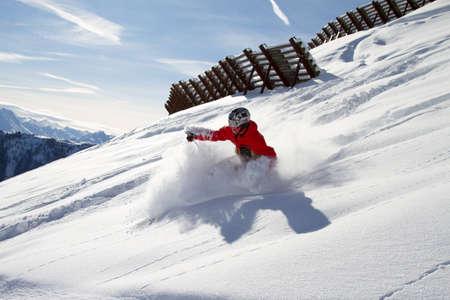 powder snow: skier turning in powder snow