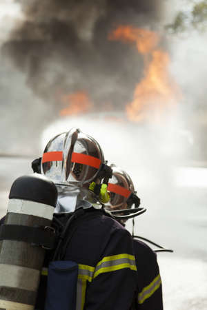 Brave french firefighter put out fire with water hose