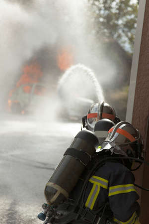 Fire brigade firefighter with fire hose Stock Photo