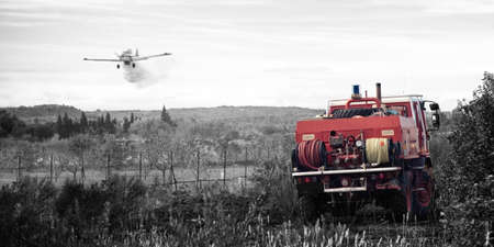 B&W and red photography red firefighter truck and plane take water protection